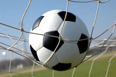 Soccer Ball in Net, Scoring Goal  Stock Photo - 939322