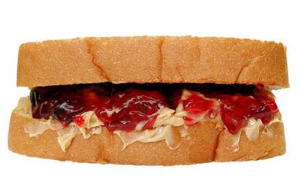 cacahuate: Crema de cacahuate y jalea Sandwich del camino con la saturaci�n  Foto de archivo