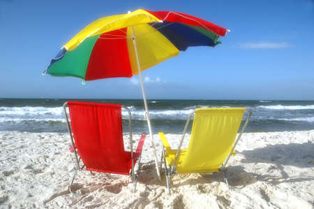 beach chairs: Beach scene with beach chairs and unbrella.