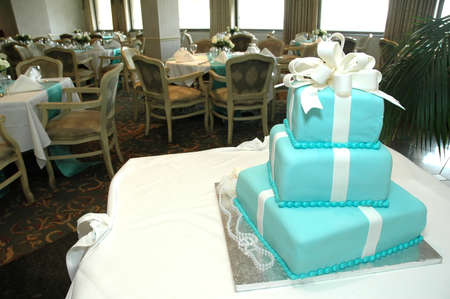 Formal birthday cake in dining room of restaurant.