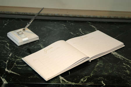 Guest book on table at special occasion.