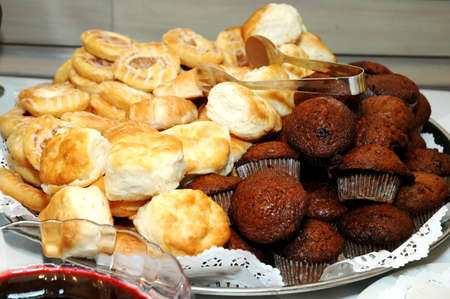 sumptuous: Muffins, biscuits, and pastries on buffet table at restaurant.