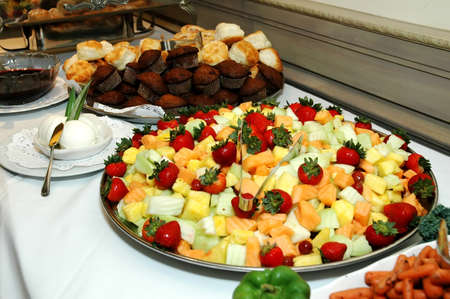 Assorted breads and fruits on buffet table at restaurant.