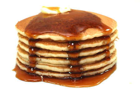 Stack of pancakes and syrup isolated on white background. Banco de Imagens