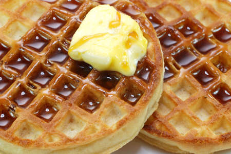 waffles: Closeup of waffles with syrup and butter.