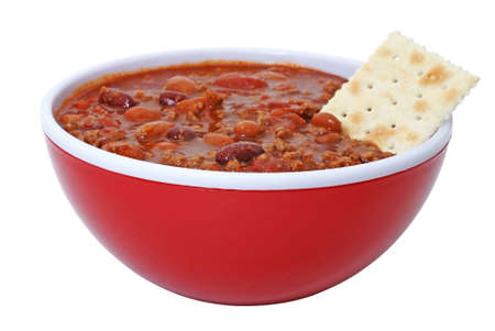 Bowl of hot chili with beans and cracker.