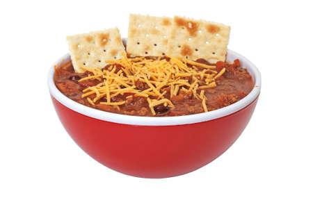 豆、チーズ、クラッカーとホット チリのボウル。 写真素材 - 2089697