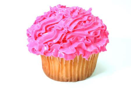 装飾的なピンクのフロスティングとケーキ。 白い背景上に分離。