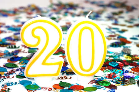 Number 20 celebration candle with confetti.