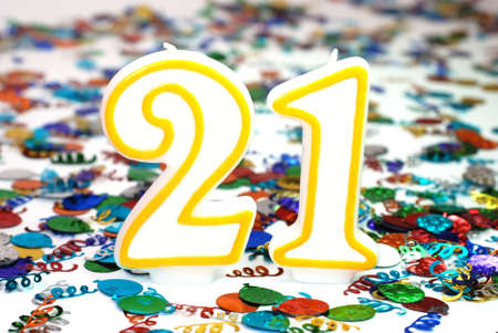 21: Number 21 celebration candle with confetti.