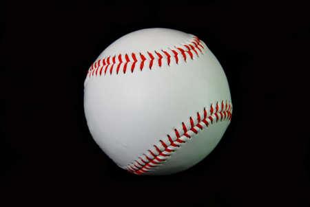 Single baseball on black background. Stock Photo