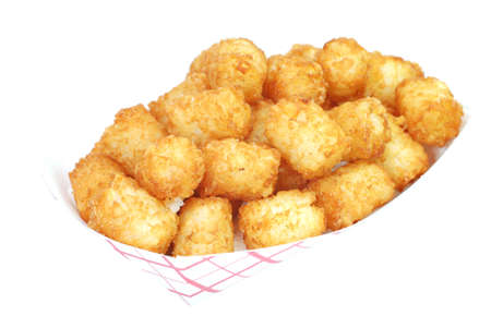 spud: Fried tater tots in basket.  Isolated on white background.