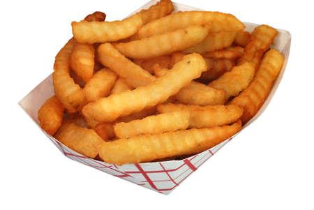 papas fritas: Franc�s fritas en la cesta de aislados Foto de archivo