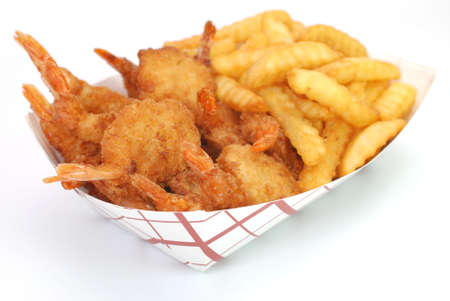 Fried shrimp and french fries basket isolated on white background. Stock Photo