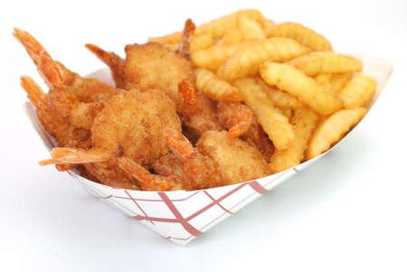 basket: Fried shrimp and french fries basket isolated on white background. Stock Photo