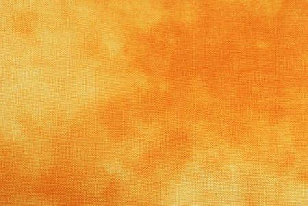 オレンジのマクロ絞り染め背景用ファブリック。