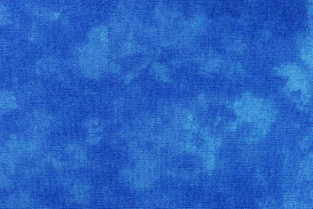 Macro of blue tie-dyed fabric for background use.  photo