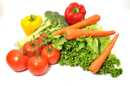 carotene: Green leafy lettuce, tomatoes, carrots, and bell peppers isolated on white background.l Stock Photo