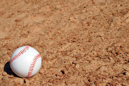 Baseball on dirt infield with copy space. Stock Photo - 4379585