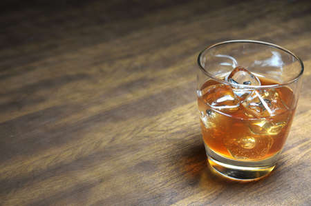 Bourbon on the rocks on wooden table with copy space. Stock Photo - 4417073