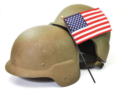 Military helmets and American flag isolated on white background.