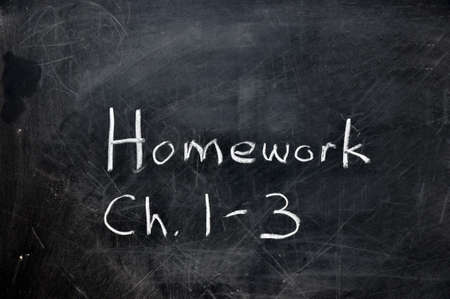 assignment: Homework assignment on black chalkboard with copy space.