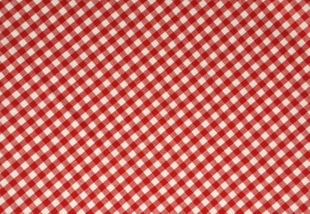Red gingham fabric background.