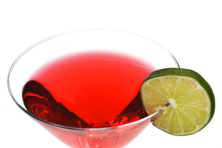 Red Cosmopolitan with lime slice isolated on white background.