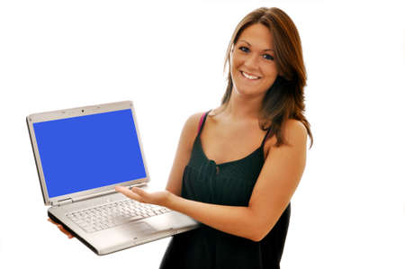 Smiling girl pointing to computer with blue screen. photo