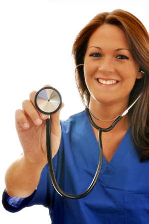 Smiling female nurse pointing stethoscope at camera. Stock Photo - 5183854