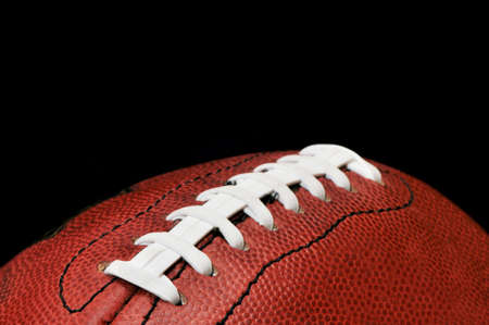 American football closeup isolated on black background.   Stock Photo