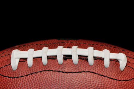 American football closeup isolated on black background.