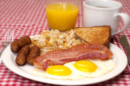 hash: Breakfast plate with eggs sunny side up, bacon, link sausage, hash browns, toast, coffee, and orange juice.