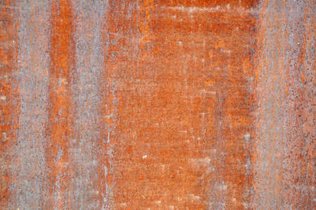 красноватый: Reddish stone background with texture detail.