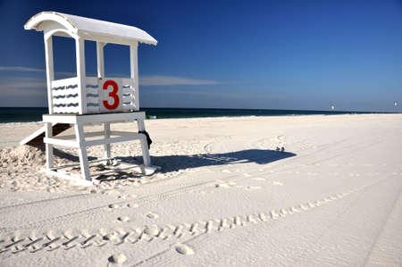 Empty lifeguard hut and seagulls on deserted beach. photo