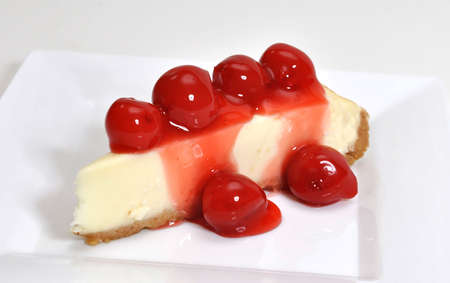 Cherry cheesecake isolated on white background.