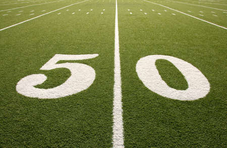 Closeup of 50 yard line on American football field. Stock Photo