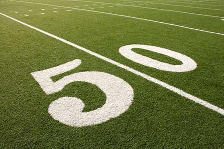 yardline: Closeup of 50 yard line on American football field. Stock Photo