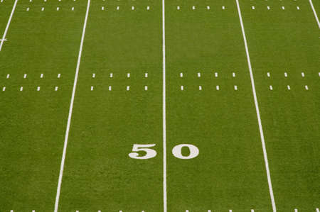 Empty American football field showing 50 yard line. Zdjęcie Seryjne - 7625471
