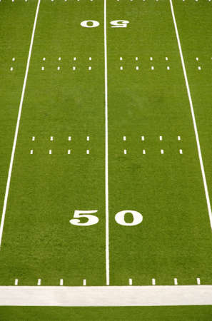 yardline: Empty American football field showing 50 yard line.