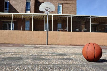 Outdoor basketball court in schoolyard. photo
