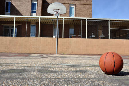 recreation area: Outdoor basketball court in schoolyard. Stock Photo