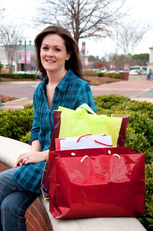 Female shopper resting while on shopping spree.