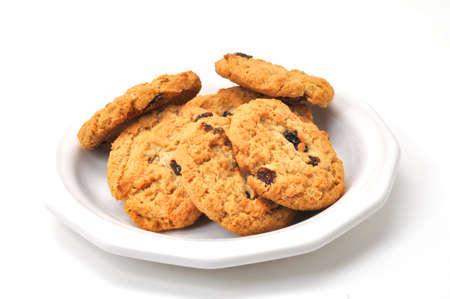 プレートの白い背景で隔離のオートミール クッキー。 写真素材