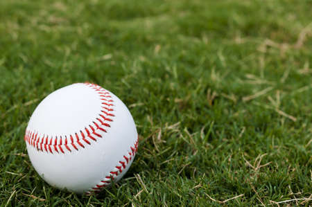 Closeup of baseball on grass with copy space. Stock Photo