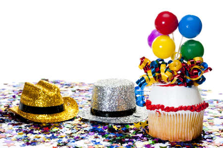 Decorated cupcake, confetti, and cowboy hats at party. Stock Photo - 10436836
