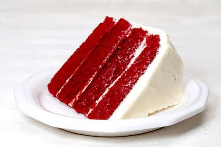 Slice of red velvet cake on plate.