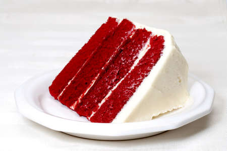 Slice of red velvet cake on plate.