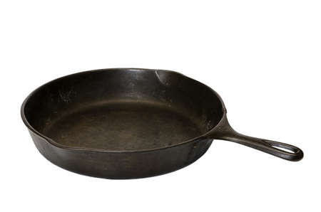 Cast iron skillet isolated on white background with clipping path. Stock Photo