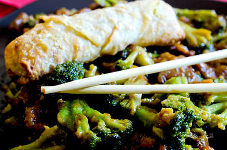 Beef with broccoli with spring roll and chop sticks  写真素材